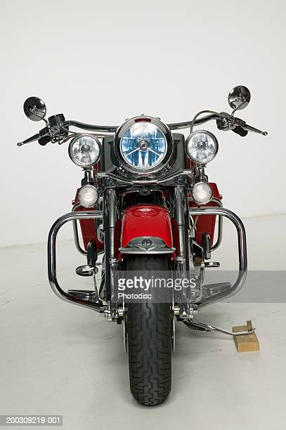 Red motorcycle parked in studio