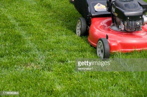 Red Mower Cutting Tall Grass
