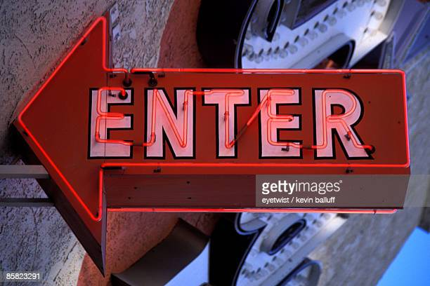 Red neon enter sign