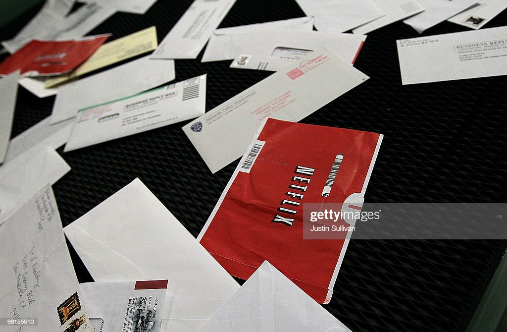 Red Netflix envelopes move on a conveyor belt with other mail at the U.S. Post Office sort center March 30, 2010 in San Francisco, California. If the U.S. Postal Service wins its bid to drop Saturday delivery service, customers of the popular online video rental company Netflix could see gaps in DVD delivery and will have to do without Saturday delivery, a popular day to receive movies.