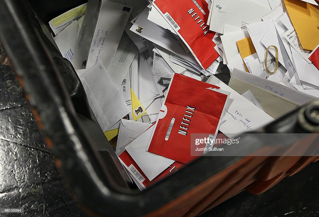 Red Netflix envelopes sit in a bin of mail at the U.S. Post Office sort center March 30, 2010 in San Francisco, California. If the U.S. Postal Service wins its bid to drop Saturday delivery service, customers of the popular online video rental company Netflix could see gaps in DVD delivery and will have to do without Saturday delivery, a popular day to receive movies.