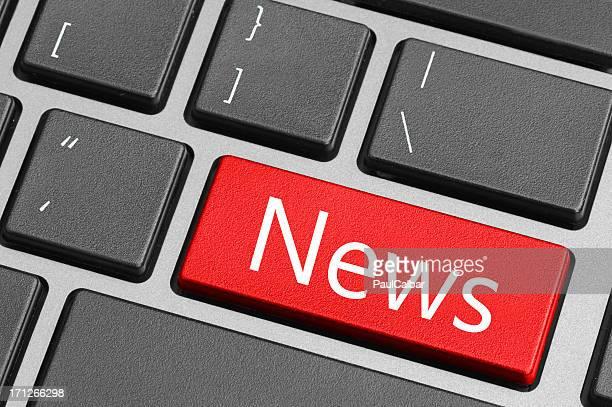 A red news key on a black keyboard