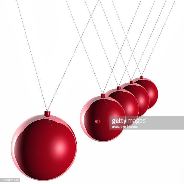 Red Newton's Cradle on White Background