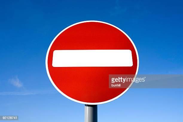 red no entry sign: do not enter against blue sky