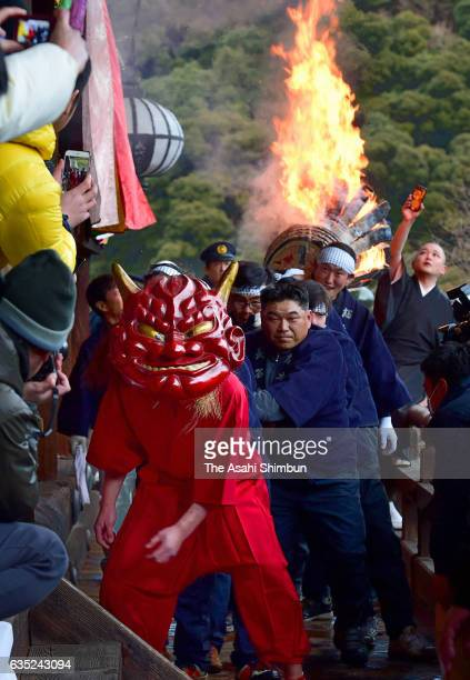 A red ogre escapes from a big flaming torch during the 'Dada Oshi' ritual as a part of 'Shunie' ceremony at Hasedera Temple on February 14 2017 in...