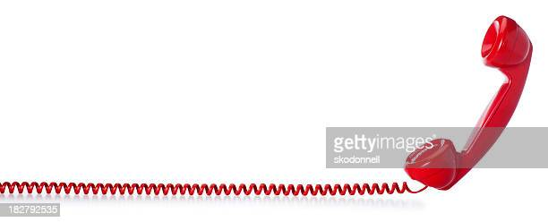Red Old Fashioned Telephone on a White Background