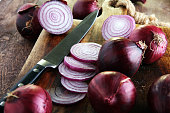 Red onions circles and red onions on board