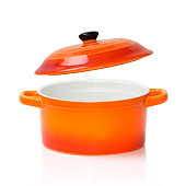 Orange red ceramic cooking kitchen pot pan with an open cover opened isolated on white.