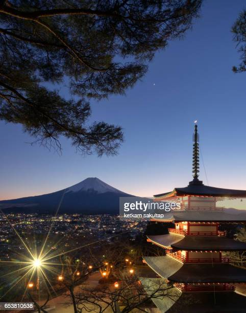 Red Pagoda and Mt. Fuji at dusk.