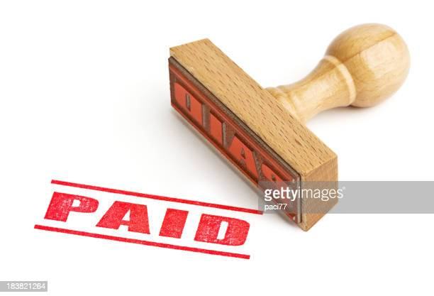 Red paid sign stamp against white background