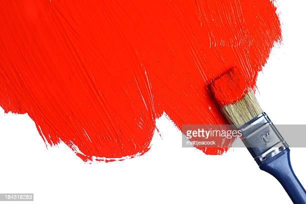 Rote Farbe auf einem Pinsel