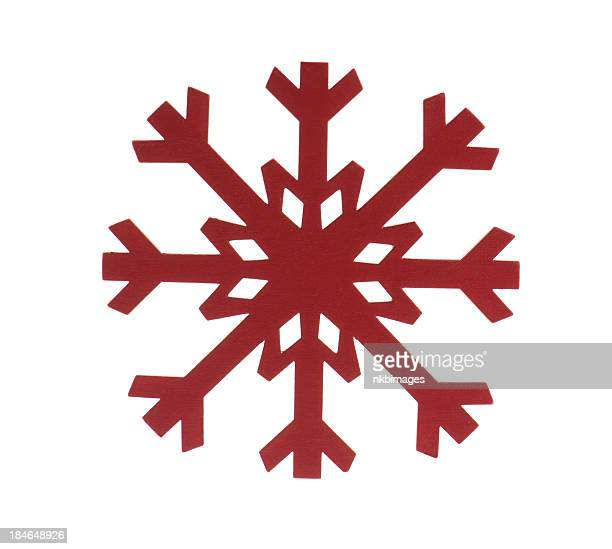 Red painted wooden snowflake on white background