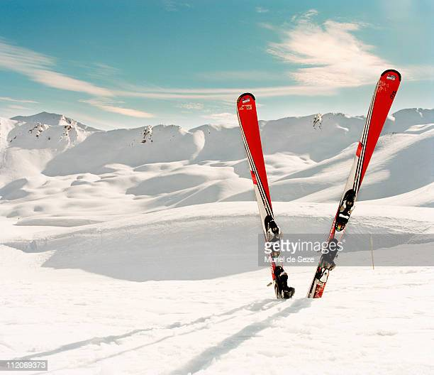 Red pair of ski in snow