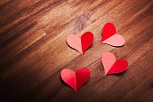 Red paper hearts on wood surface