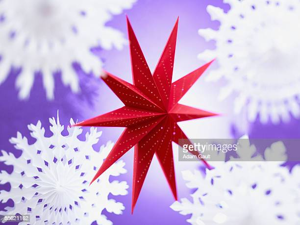 Red paper star and snowflakes