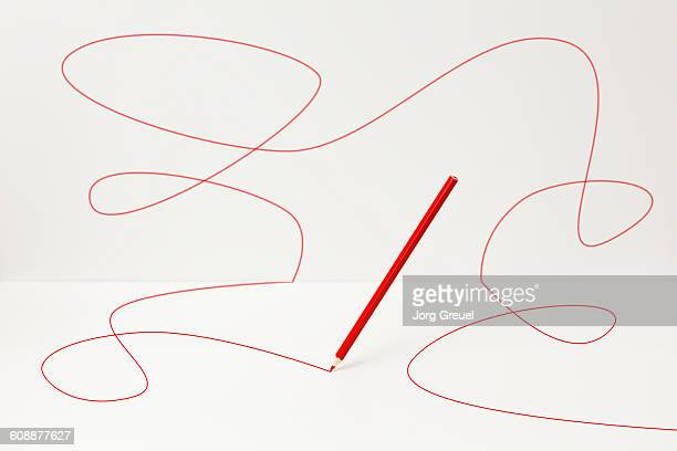 Red pencil drawing a line