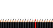 Red pencil standing out from the same row crowd black bold pencils on white background, with space for text. Leadership, unique, independence, initiative, strategy, dissent, think different, business