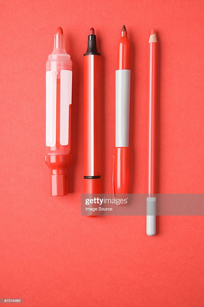 Red pens and pencil