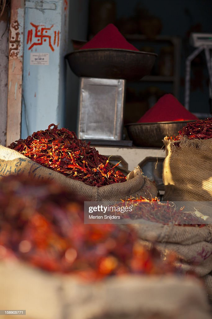 Red peppers and powder on market : Stock Photo