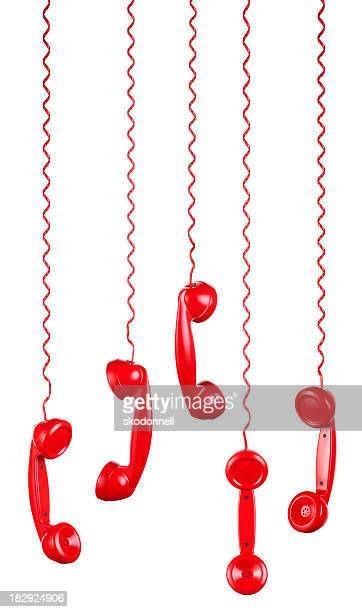 Red Phones Hanging on a White Background