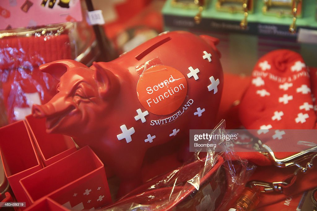 A red 'Piggy Bank' branded with the Swiss national emblem sits for sale in a souvenir shop in Davos, Switzerland, on Friday, Jan. 17, 2014. Next week the business elite will gather in the Swiss Alps for the 44th annual meeting of the World Economic Forum (WEF) in Davos for the five day event which runs from Jan. 22-25. Photographer: Simon Dawson/Bloomberg via Getty Images