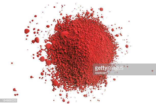 Red pile of pigment powder on white