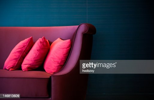 red pillows on a sofa : Stock Photo