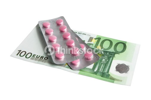 Red pills and 100 euro : Stock Photo