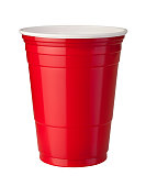 Red plastic party cup shown with shiny reflective highlight. This container is popular at parties because it is strong and disposable. The image is isolated on a white background, and includes a clipp