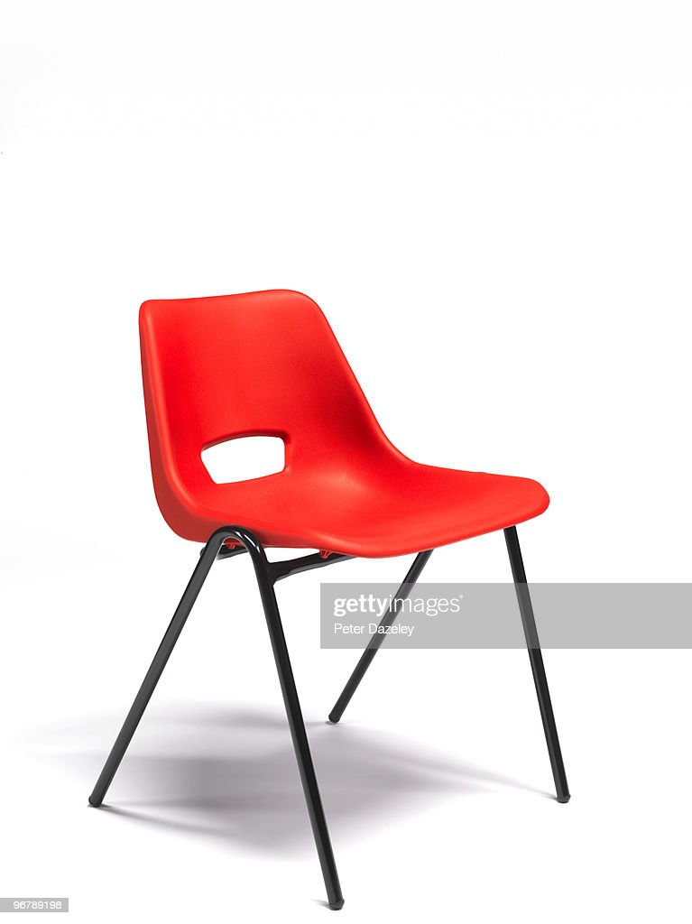 Red plastic stacking chair with copy space : Stock Photo
