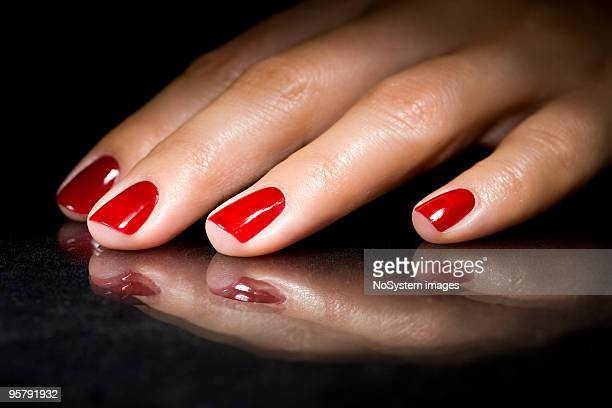 Red polish nails