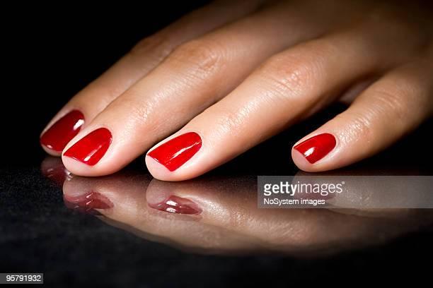 Red polish nails