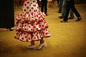Red polka dot frock girl in Seville fair