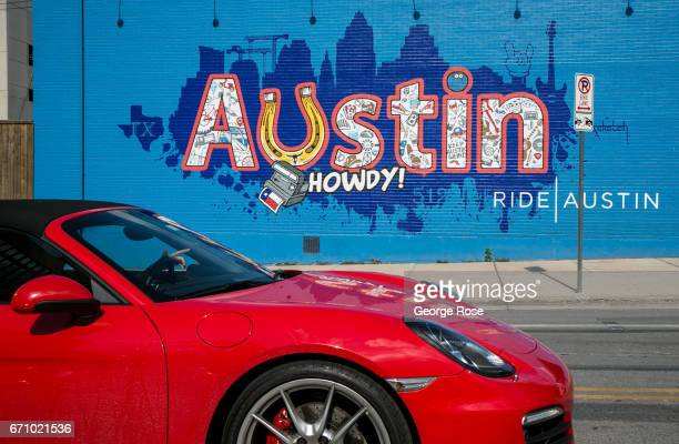 A red Porsche drives past a colorful downtown wall mural on April 14 in Austin Texas Austin the State Capital of Texas the state's second largest...