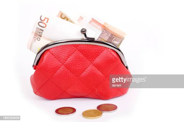 A red purse full of European money