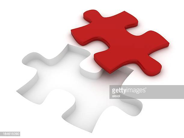 Red puzzle piece lying besides its white setting