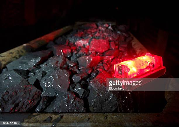 A red rear light sits illuminated on rail trucks loaded with rocks containing uranium ore at Rozna mine operated by Geam a division of Diamo SP...