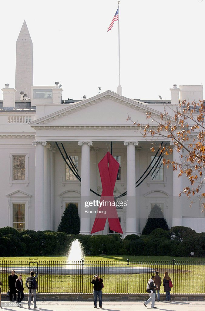 A red ribbon adorns the North Portico of the White House in Washington DC US on Nov 30 to mark World AIDS Day tomorrow December 1 US President George...