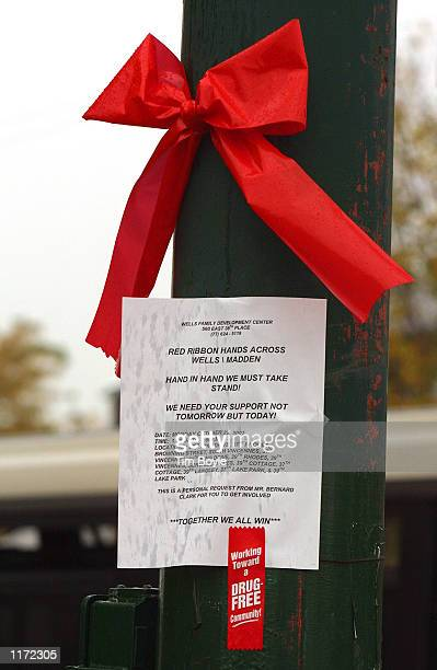 A red ribbon and related signage hang on a light post along a Chicago street October 22 2001 as part of National Red Ribbon Week activities Community...