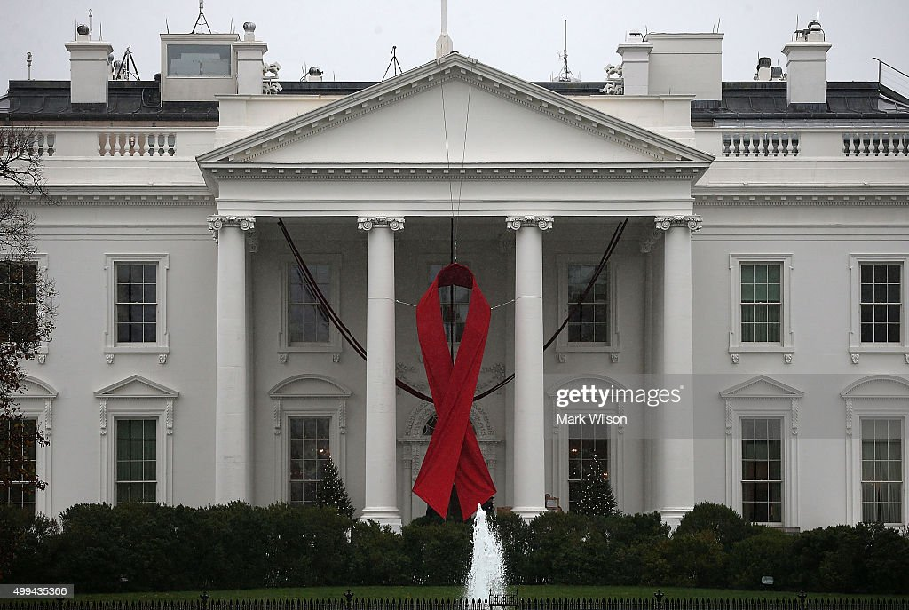 A red ribbon is displayed on the North Portico of the White House to recognize World AIDS Day, December 1, 2015 in Washington, DC. World AIDS Day has been observed on December 1, since 1988, and is dedicated to raising awareness of the AIDS pandemic caused by the spread of HIV infection, and to mourn those who have died from the disease.