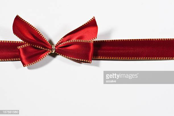 red ribbon with golden seam