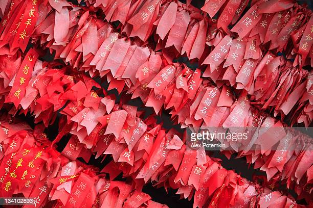 red ribbons with wishes. Buddhist Temple, Kunming, Younnan province, China