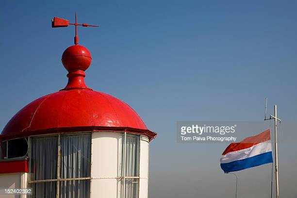 Red roof with weather vane