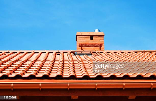 Red rooftop with small chimney