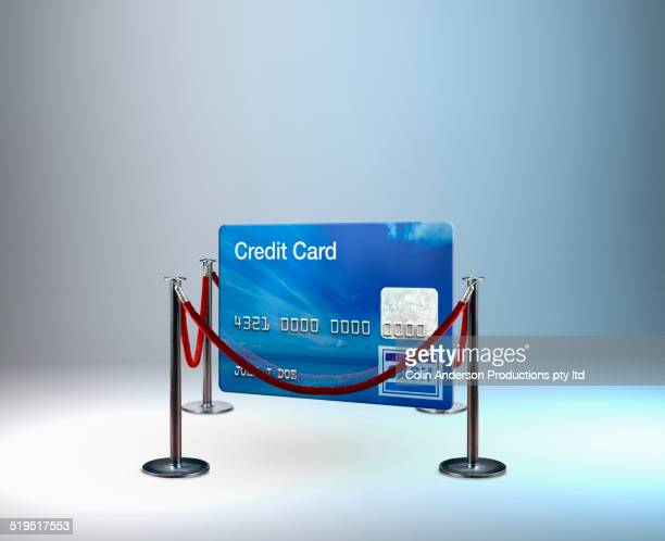 Red rope barrier around credit card