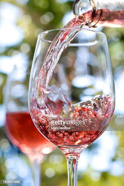 Red rose wine alfresco in glasses