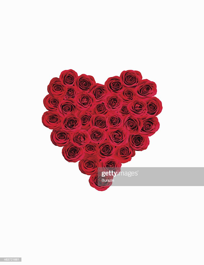 Red roses laid out in the shape of a heart : Stock Photo