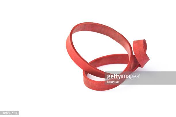 Red rubber band twisted into a topological shape