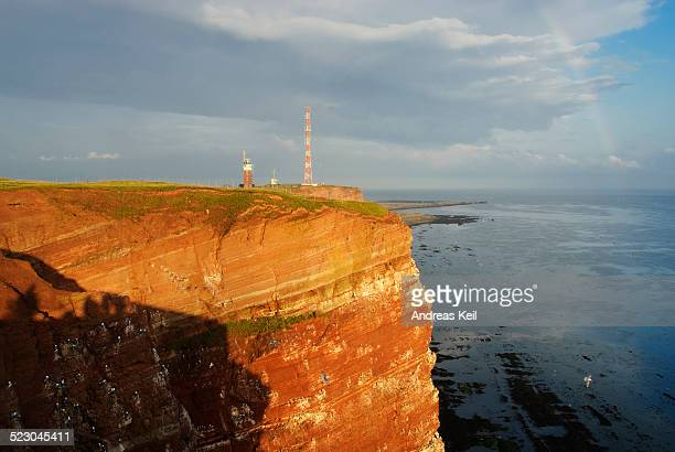 Red sandstone cliffs of Heligoland in the evening light with a rainbow, Oberland, Heligoland, North Sea, Schleswig-Holstein, Germany, Europe