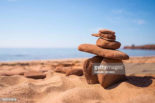 Red sandstone Inuksuk on a PEI red sand beach